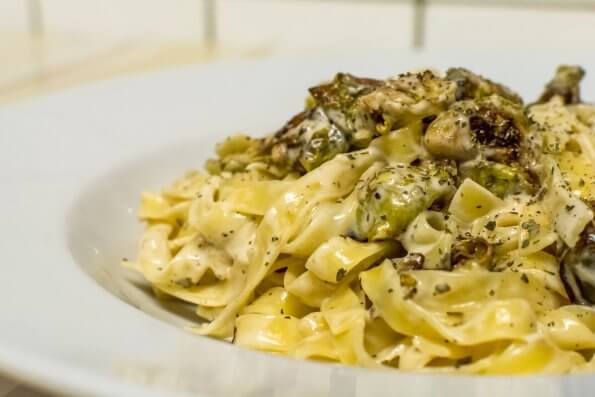 Tagliatelli with brussels sprouts in garlic soy cream sauce