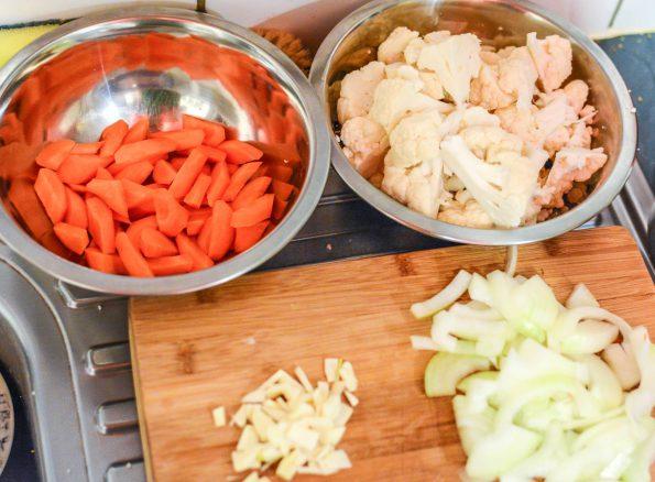 Sliced carrots, cauliflower, garlic and onion
