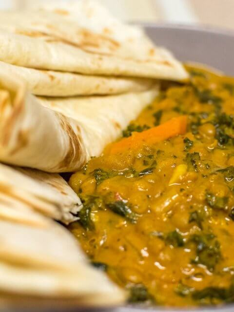 lentil and kale curry with flour tortilla